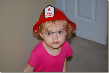 Gabby in her Fire Chief hat from Touch-A-Truck
